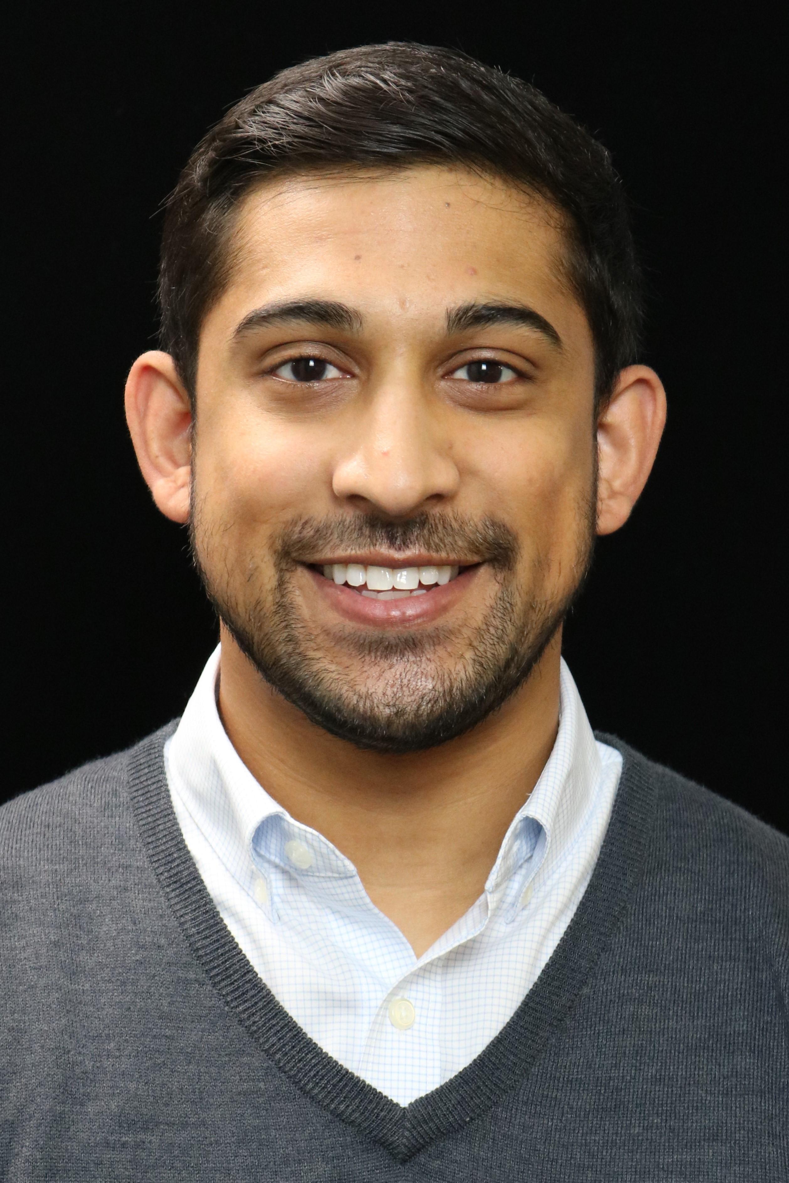 headshot of Sadeq Khan