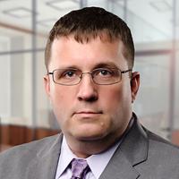 headshot of John Buscher